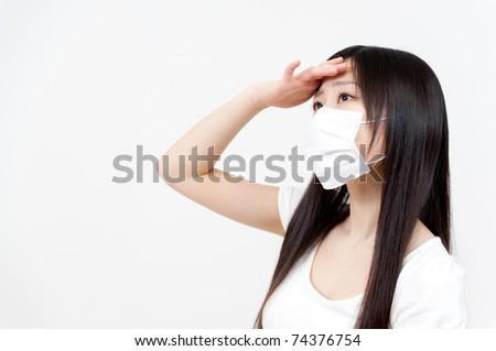 beautiful asian woman with a headache - stock photo