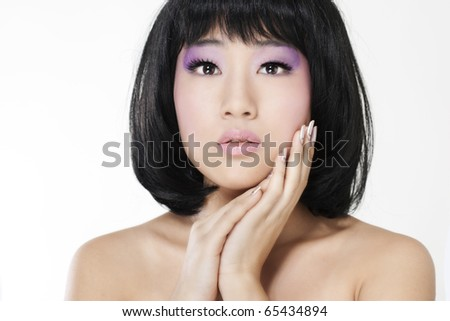 Beautiful asian woman with bright makeup isolated on white background.