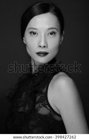 Beautiful asian woman with lipstick and black dress, black and white