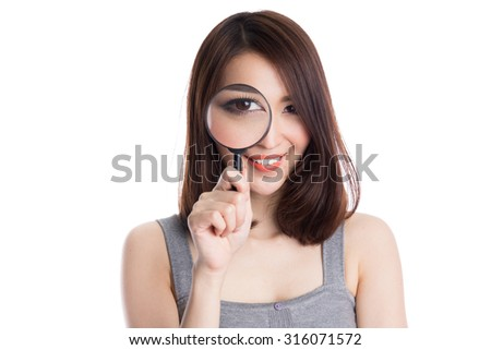 Beautiful asian woman with magnifying glass