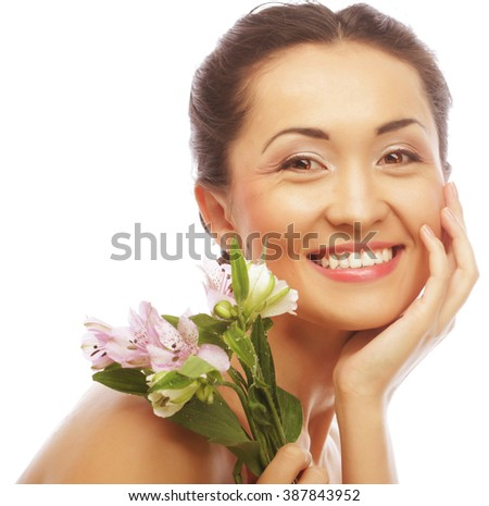 Beautiful asian woman with pink flowers - stock photo