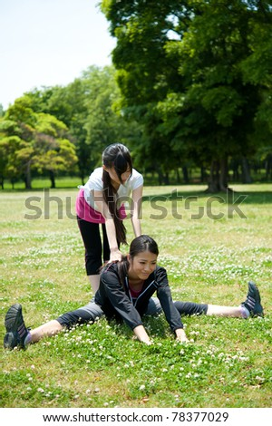 beautiful asian women exercising in the park