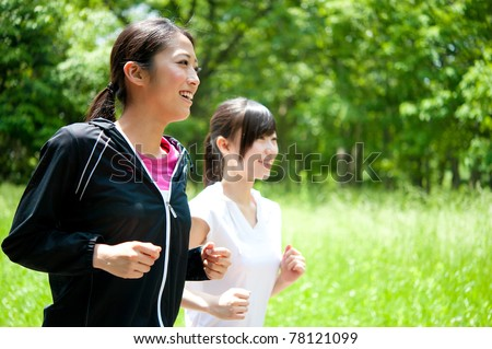 beautiful asian women jogging in the park - stock photo