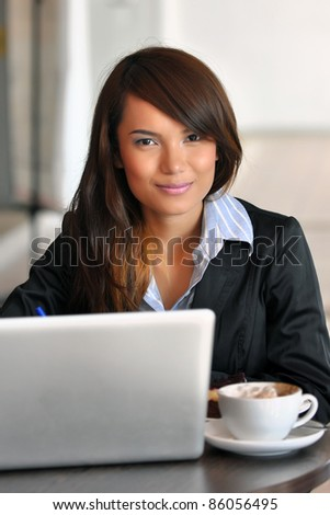 Beautiful asian young businesswomen smile in cafe - stock photo