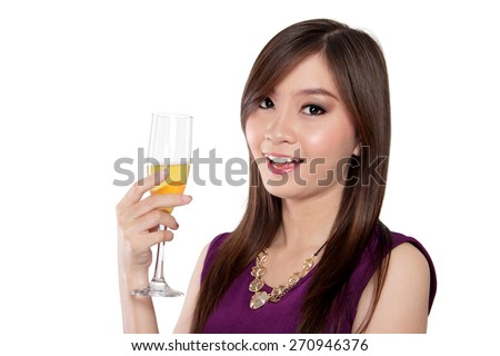 Beautiful Asian young woman hold a glass of champagne and smile at camera, isolated on white background