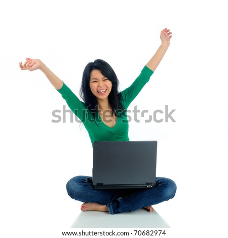 Beautiful Asian Young Woman Sat On The Floor With A Laptop Computer