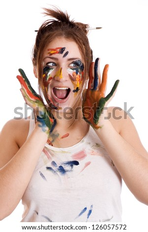 beautiful astonished girl with hands in the paint isolated - stock photo