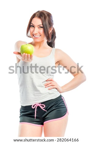 beautiful athlete holds a green apple - stock photo