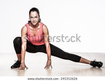 Beautiful athlete woman doing fitness exercise - stock photo