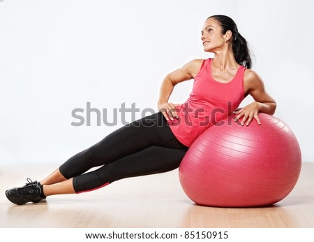 Beautiful athlete woman with a fitness ball. - stock photo
