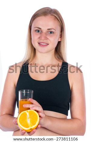 Beautiful athletic blonde girl with a glass of orange juice. Young woman holding orange and juice - stock photo
