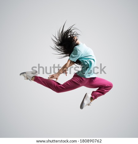 beautiful athletic girl dancing jumping - stock photo