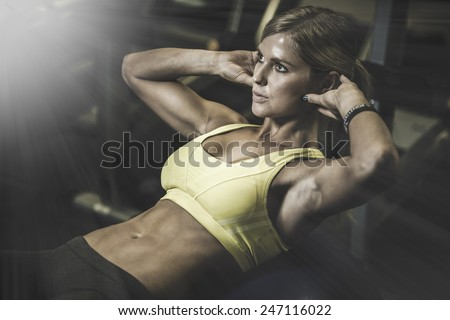 beautiful athletic woman working ab intervals in fitness - stock photo