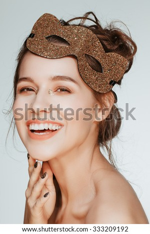 Beautiful attractive charming young brunette woman portrait closeup smiling in mask, nude natural fresh makeup. - stock photo