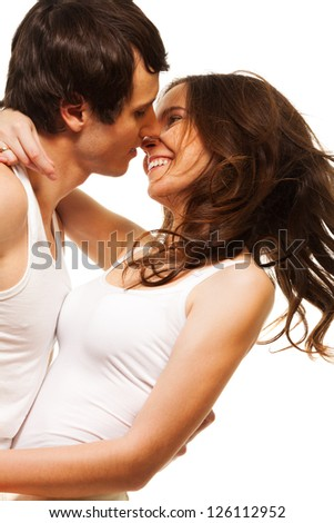 Beautiful attractive laughing girl smiling and kissing his boyfriend - stock photo
