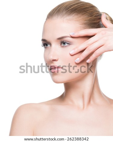 Beautiful attractive woman with healthy skin looking side - isolated on white background.  - stock photo