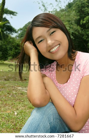 Beautiful attractive young Asian / Latino teenage girl smiling happily