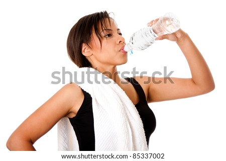 Beautiful attractive young sweaty woman drinking water after exercise workout, rehydrating thirst quenching, isolated. - stock photo