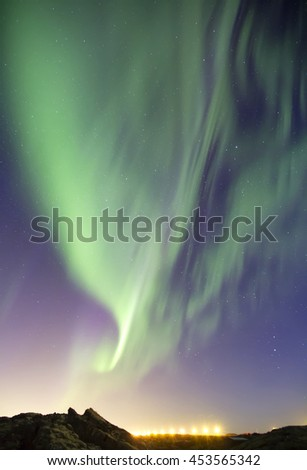 Beautiful aurora borealis northern lights display in a night sky, Iceland.