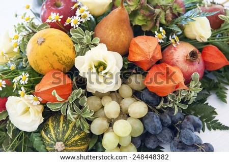 Beautiful autumn composition with flowers and fruit - stock photo