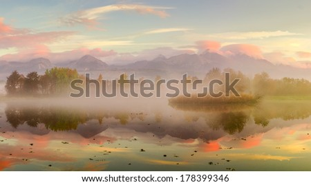 Beautiful Autumn Fall landscape over foggy misty lake - stock photo