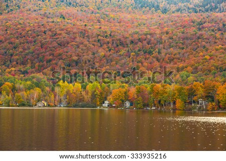 Beautiful autumn foliage and cabins in Elmore state park, Vermont. - stock photo