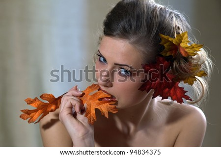 Beautiful Autumn Girl and make-up - stock photo