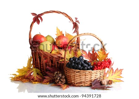 beautiful autumn harvest in baskets and leaves isolated on white - stock photo