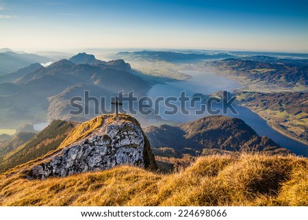 Beautiful autumn landscape in the Alps with mountain tops and lakes in golden evening light - stock photo