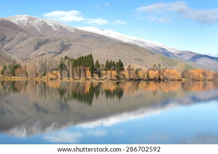 beautiful autumn landscape with reflecting bright trees