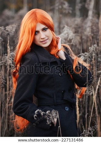 Beautiful autumn portrait of red haired caucasian girl - stock photo