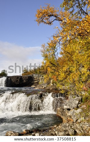 Beautiful autumn scene around waterfall in Abisko national-park, Lapland, Sweden.