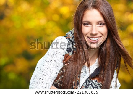 Beautiful autumn woman in golden park - stock photo