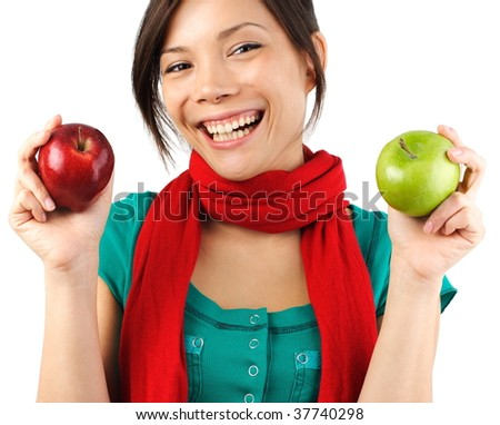 Beautiful autumn woman with red and green apples. Isolated on white.