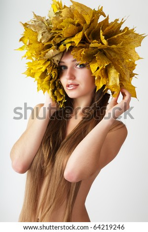 Beautiful autumn women. At the woman an autumn wreath on a head. - stock photo
