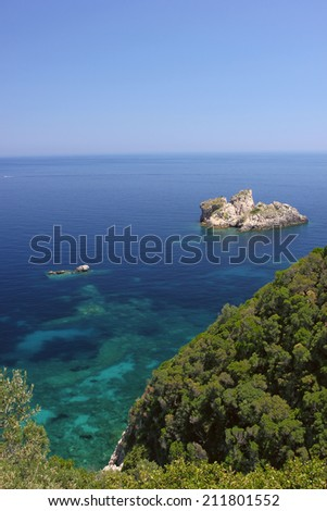 Beautiful azure seascape with transparent turquoise sea. Corfu, Greece - stock photo
