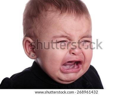 beautiful baby crying isolated on white - stock photo