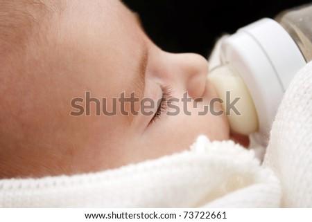 Beautiful baby  drinking milk - stock photo