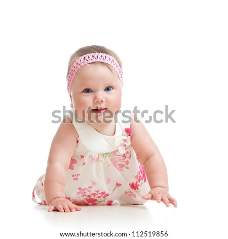 beautiful baby girl crawling on floor over white background - stock photo