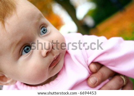 Beautiful baby girl curious with her surrounding, enjoying the fresh outdoor - stock photo