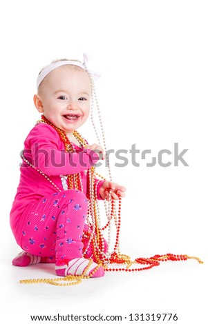 beautiful baby girl. little baby with the decorative beads - stock photo