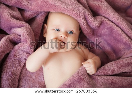beautiful baby girl lying on white bed - stock photo