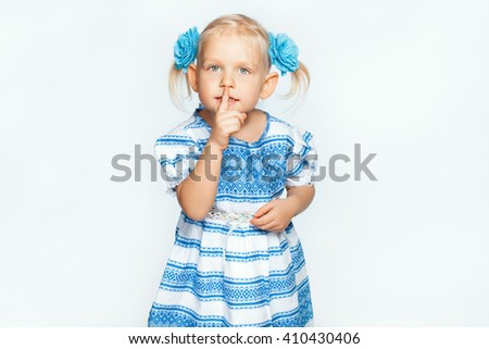 Beautiful baby girl on a white background making shh - stock photo