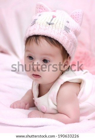 Beautiful baby girl on pink background