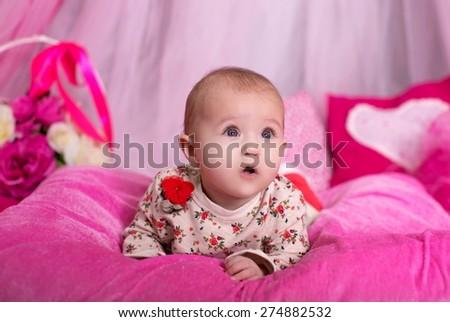 Beautiful baby girl on pink background - stock photo