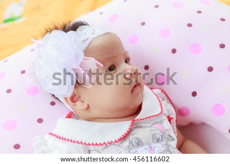 beautiful baby girl on the bed.