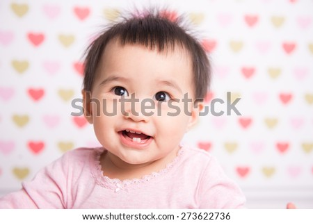 Beautiful baby girl smiling a happy smile - stock photo