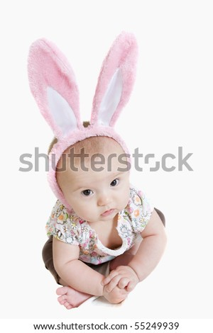 Beautiful baby girl wearing pink bunny ears - stock photo
