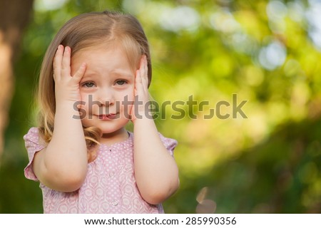 beautiful baby girl with blonde hair outdoors. Little girl 2-3 year old - stock photo