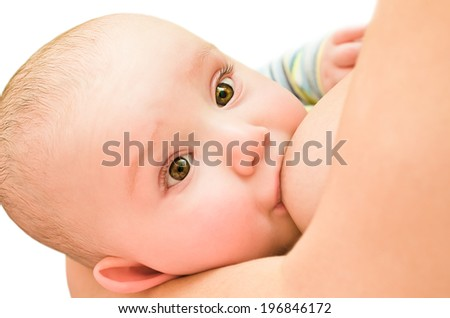 Beautiful baby is fed mother's milk isolated on white background - stock photo